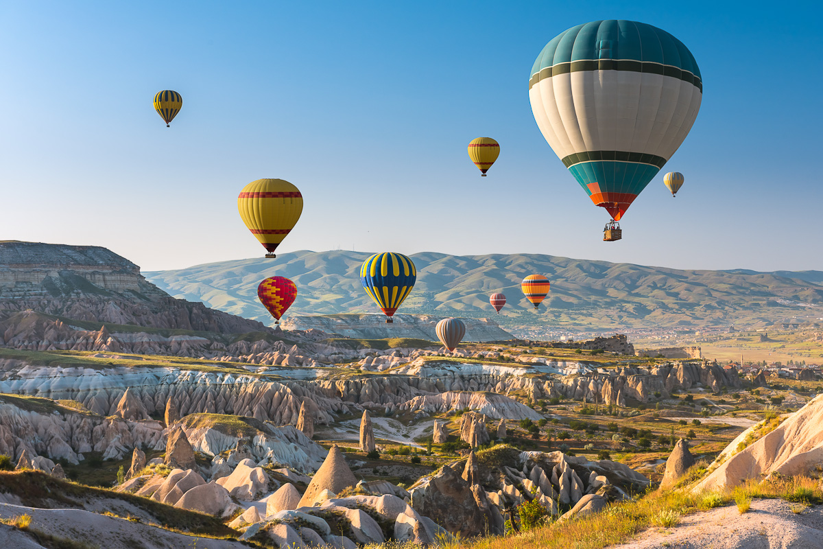 Hot,Air,Balloons,Flying,In,Sunset,Sky,Cappadocia,,Turkey